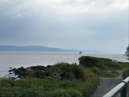 The ship in the distance is the famous Galway Hooker, a fishing boat.
